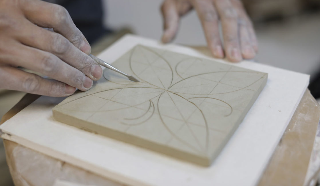 Rich Miller making tiles. Photo Layton Thompson for Ceramic Review
